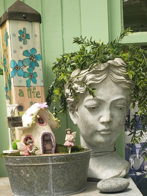Unique planters or decorative birdhouses can add pizzazz to outdoor areas.