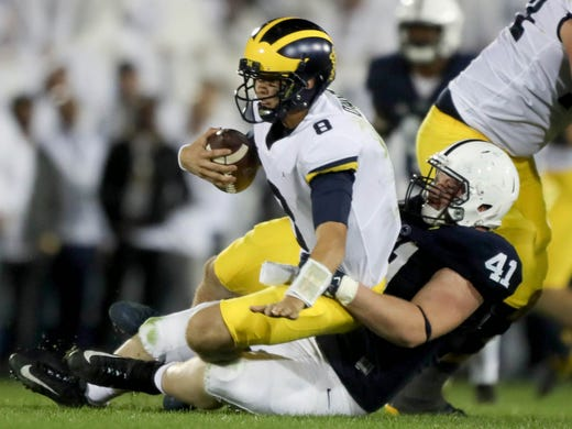 Michigans John Okorn Is Sacked By Penn States Parker
