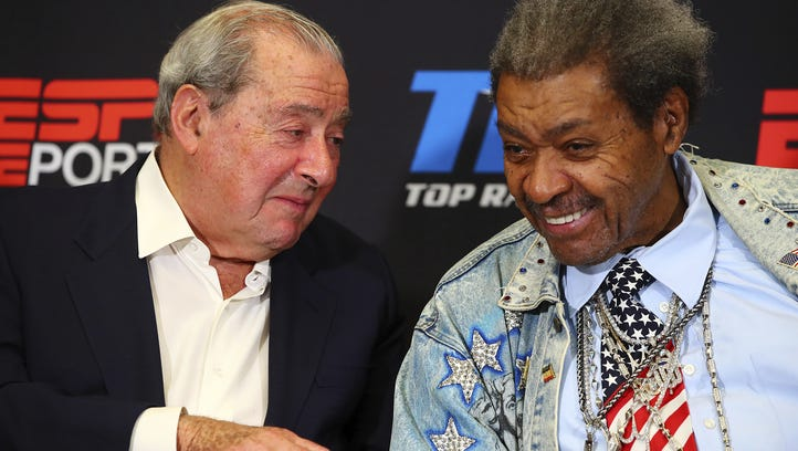 Bob Arum and Don King chat during a news conference