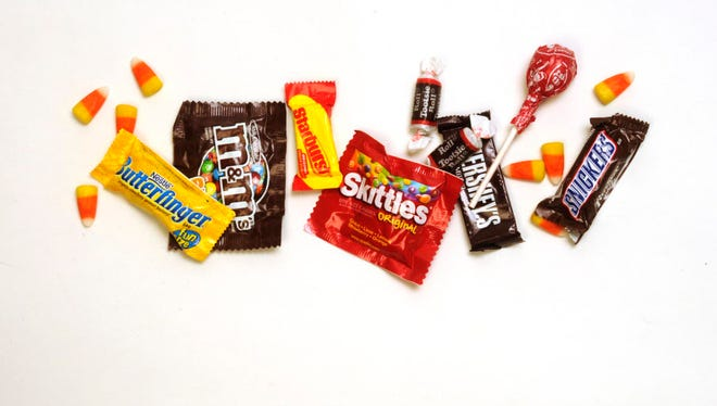 "Police are advising parents to  check the candy their children received while trick-or-treating as there were reports of ""needle-like"" objects found in some candy."