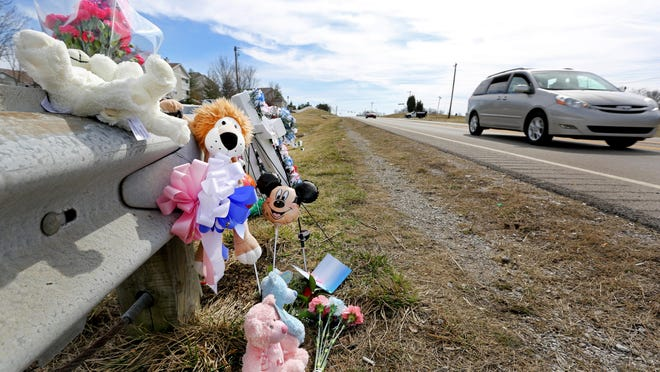 Charles Napier, 49, of Florence, and his 13-month-old twin grandchildren, Sean and Samantha May, were killed March 15, 2015, after a car struck them while they were walking along Weaver Road in Florence. A makeshift memorial was quickly put in place at the scene.