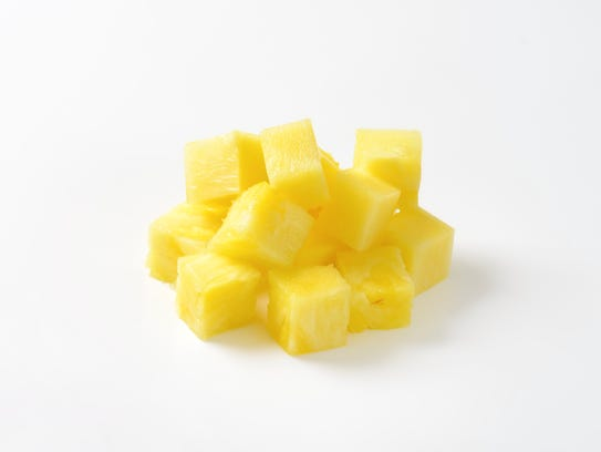 Pile of fresh pineapple cubes