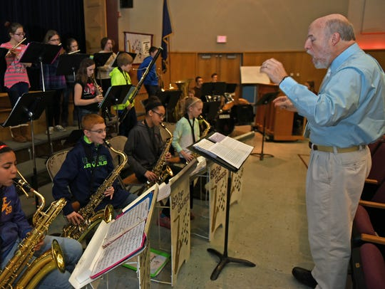 Instructor Mark Wilson directs young musicians during