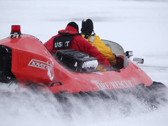 Crews search in the frigid waters of Conesus Lake for two people believed to have fallen through the ice.