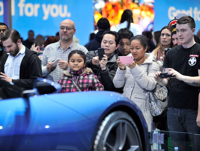 Visitors check out and take photos of the Ford GT at