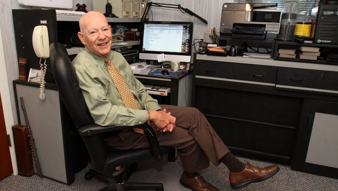 Charles Burke of Howell, who offers seminars to nonprofits on how they can find funding, sits in his office at his home in Howell.