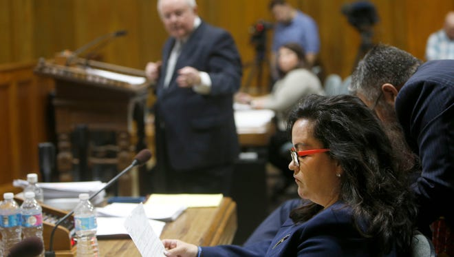 Kristi Fulnecky looks at documents during a hearing regarding her recording of a meeting in November.