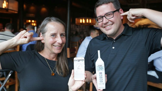 IndyStar dining reporter Liz Biro uses a free app and acoustical consultant Gavin Haverstick his professional device t test noise at restaurants on Mass Ave.