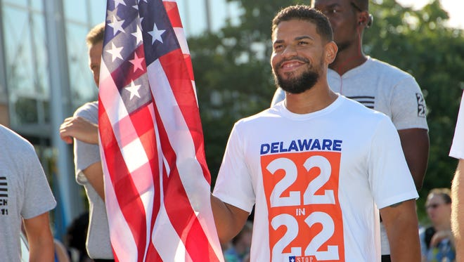 Retired U.S. Marine and Delaware Technical Community College student Xavier Lopez ran with the American Flag during an eight-mile run from the DTCC Stanton campus to the Wilmington campus.