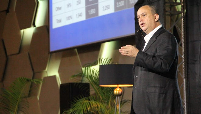 Guam Visitors Bureau chairman Mark Baldyga speaks at the Bank of Guam Economic Forum at the Dusit Thani Hotel Oct. 27.