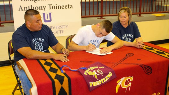 Cherokee senior Anthony Toineeta has signed to wrestle in college for Queens.