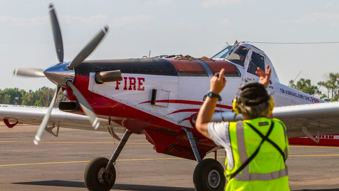 A plane prepares for takeoff at the Cedar City Airport to help fight the Brian Head fire on Wednesday, June 21, 2017.