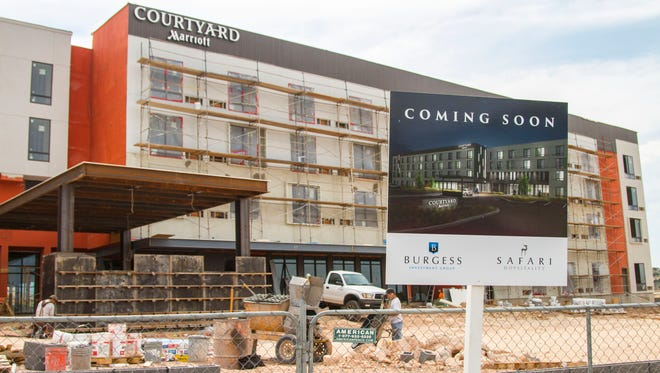 """A """"coming soon"""" sign sits on the construction site for the Courtyard Marriott in Cedar City, Thursday, Sept. 7, 2017."""