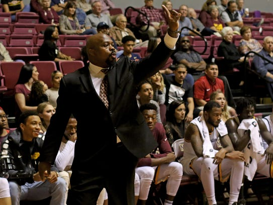 Midwestern State's Nelson Haggerty signals to his team