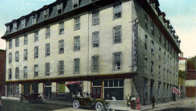 The Virginia Hotel at the corner of South New and Johnson streets, as it appeared in the early part of the 20th century. The walls and floors held some small surprises for the crew that knocked it down in 1930.