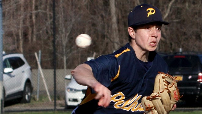 Pelham's Cameron Catana pitches to Harrison during avarsity baseball game at Pelham April 5, 2017. Harrison defeated Pelham 2-0.