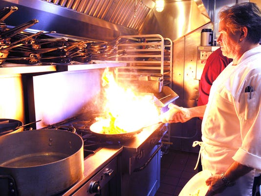 LEBANON DAILY NEWS   EARL BRIGHTBILL  Chef Kevin Brown working in the kitchen at Trattoria Fratelli, which won best Upscale/Fine Dining.