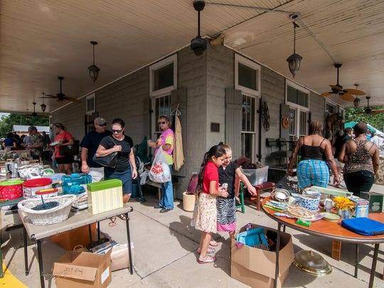 Shoppers gather at the corner of Main and E. Bridge streets during the Breaux Bridge Citywide Garage Sale.