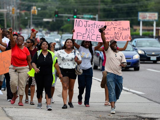 Demonstrators protest the shooting death of Michael Brown in Ferguson, Missouri, in August 2014.