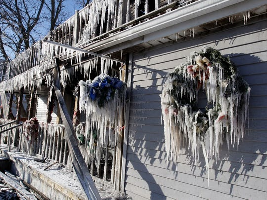 Long icicles hang from the remains of Arbuckle Floral, which was consumed by fire and took 16 fire departments to contain on Monday in Cascade.