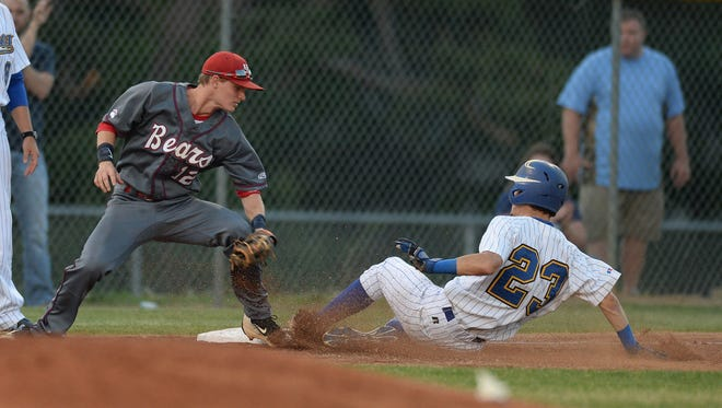 Wren's Adam Campbell (23) beats the tag of B-HP's Austin Hughes (12) at 3rd base during their AAA Upper State tournament game on Wednesday, May 11, 2016.