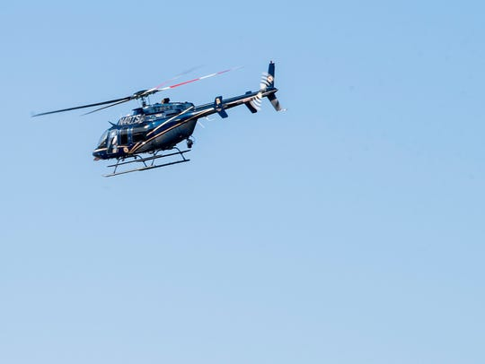 A helicopter lifts off at the search headquarters at