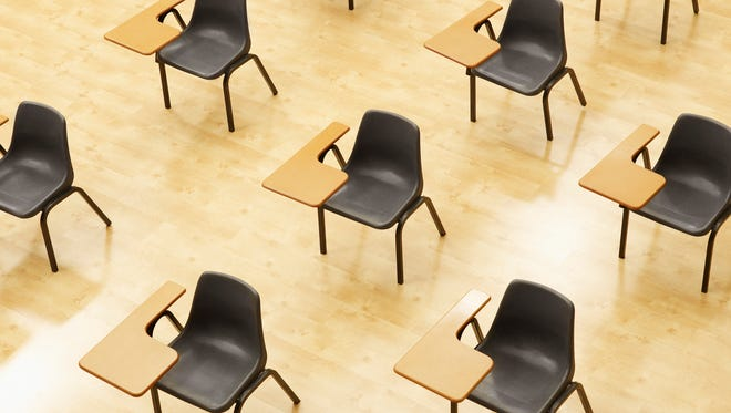 Desks in empty classroom.
