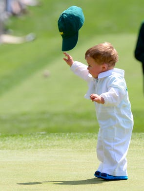 Finn Stallings the son of Scott Stallings throws his cap on the fourth green.
