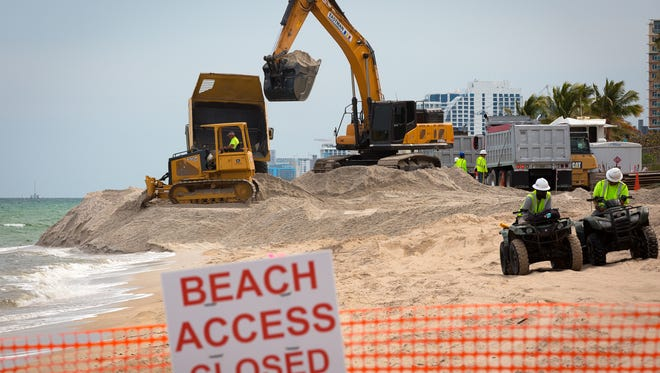 Dump trucks deliver sand from the Ortona mine to Broward County beaches as part of a $37 million beach renourishment in March 2016.