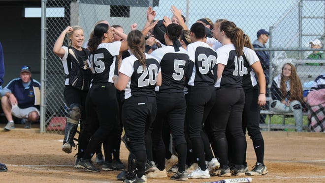Sussex Tech's congratulates Jaykayla Sample with a solo home run against Cape Henlopen during the match up on Monday. Megan Raymond Photo