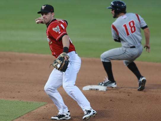 El Paso shortstop Dusty Coleman threw to first to put
