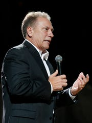 Michigan State coach Tom Izzo talks to the crowd on