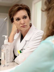 Dr. Kristy R. Kennedy consults a patient after a skin