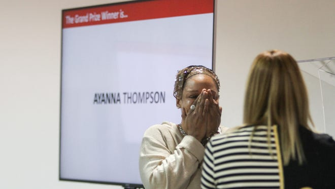 Ayanna Thompson reacts after finding out that she was the winner of a new car given to her by her employer Marketsmith in Cedar Knolls on December 8, 2016 .  Alexandra Pais/ The Daily Record