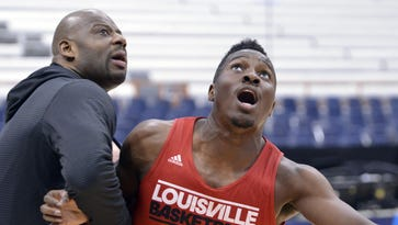 Former Louisville assistant coach Wyking Jones (left during a 2015 practice with the Cards' Chinanu Onuaku) has reportedly been named the interim head coach at Cal.