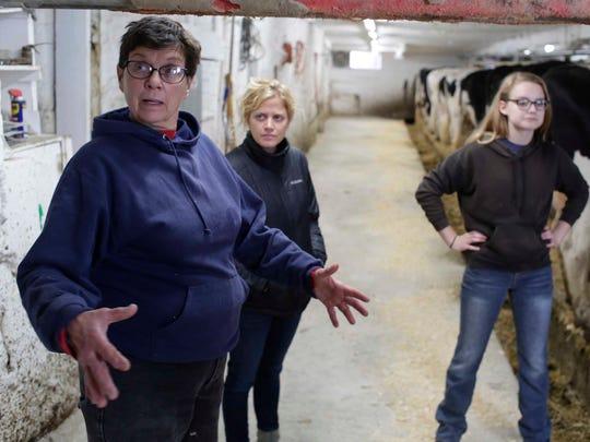 Paulette Ditter talks about her love of farming as Sartori brand ambassador Maria Sartori, center, and Ditter's granddaughter Zoe Ertel listen.