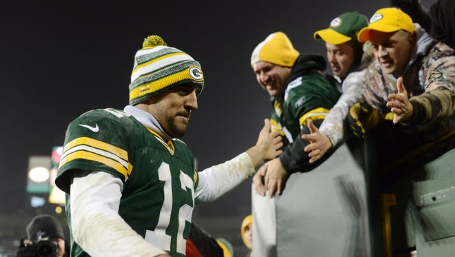 Green Bay Packers quarterback Aaron Rodgers (12) leaves the field after the win against the Atlanta Falcons at Lambeau Field.