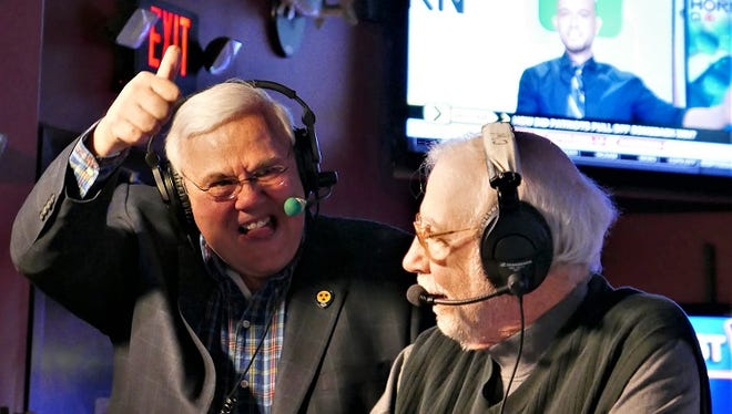 Peter Weber (left) surprises Dick Palmer with news that he will receive a lifetime achievement award from the Tennessee Radio Hall of Fame. Jan. 22, 2018, at Sam's Sports Grill in Murfreesboro's Stones River Mall.