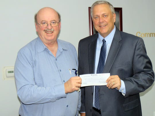 Dr. Robert Shaw, CEO of Development Centers; receives a grant check from Gary R. Ley, executive director of GCH Heritage Foundation.