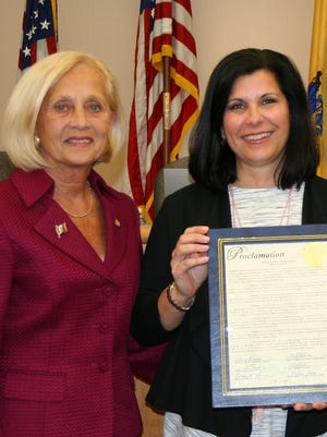 Laura DePrado (right) accepts a 2016 Horticultural Therapy Week proclamation from then-Somerset County Freeholder Director Pat Walsh.