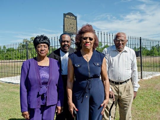 Children of Elmore Bolling, From left, Mary Magdalene Bolling Brumby, Rev. Elmore Bolling, Josephine Bolling McCall and Louis Bolling visit the site of their father's lynching on Wednesday, April 18, 2018 in Lowndes County, Ala. Elmore Bolling was shot to death during a lynching on Dec. 4, 1947.