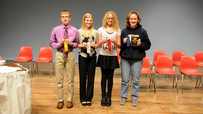 The final four spellers from the 22nd annual Ottawa County Spelling Bee at Port Clinton High School stand with their ribbons and plaque after the contest. From left to right are: Andrew Fillmore, fourth place, Port Clinton, 8th grade; Regan Draeger, third place, Woodmore, 7th grade; Phoebe Jackson, second place, Woodmore, 7th grade; and Katelyn Farmer, first place, Oak Harbor, 7th grade.