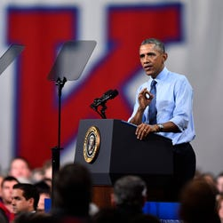 President Obama speaks to a crowd at the University of Kansas to discuss the themes from his State of the Union address, Jan. 22