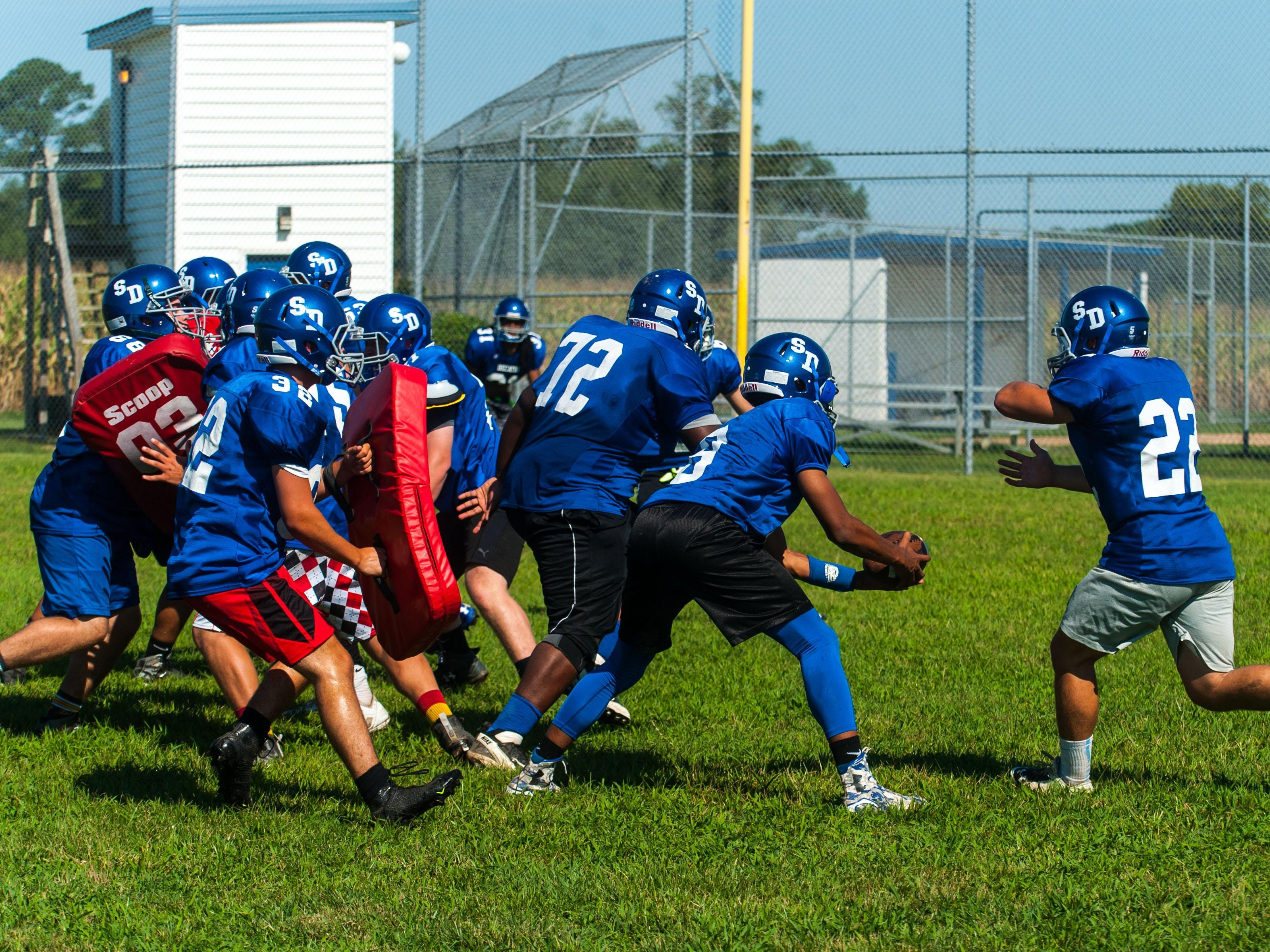 Stpehen Decatur works through offensive plays on Friday morning in Berlin.