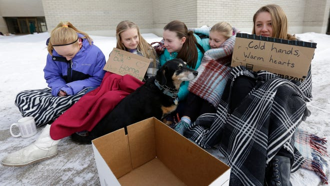Students Brooklyn Montgomery, right, Riley Sondelski, Rachel Selle, Violet Cox, and Alex Pfeiffer, pose as a homeless family Friday, January 29, 2016, at Mosinee Middle School.