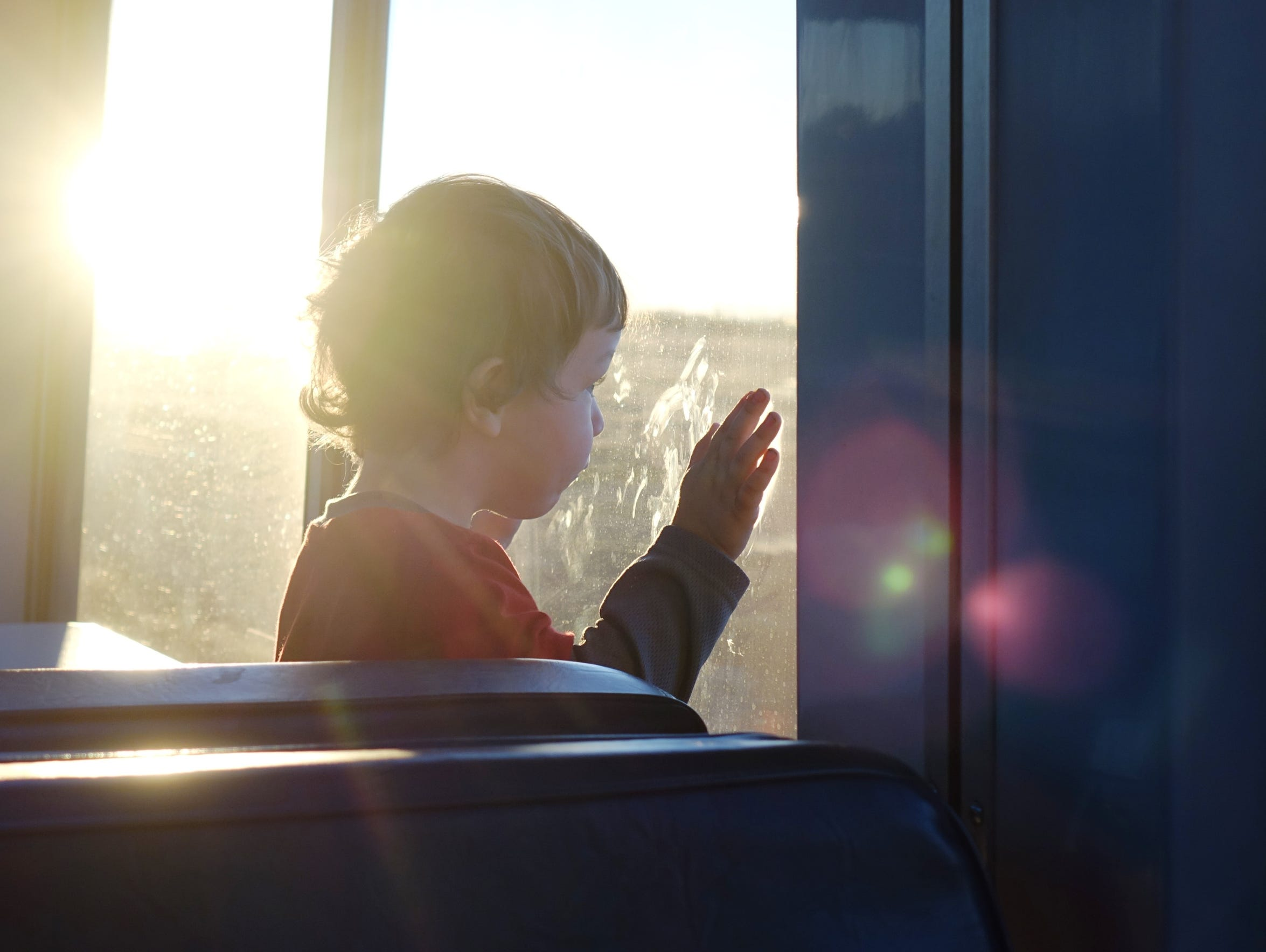 Rafe Smith, 2, peers out the window of Amtrak's Southwest