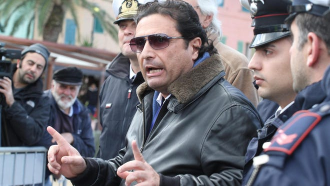 The captain of the 'Costa Concordia', Francesco Schettino speaks to journalists in Giglio harbor after returning from the shipwrecked cruise liner on Thursday.