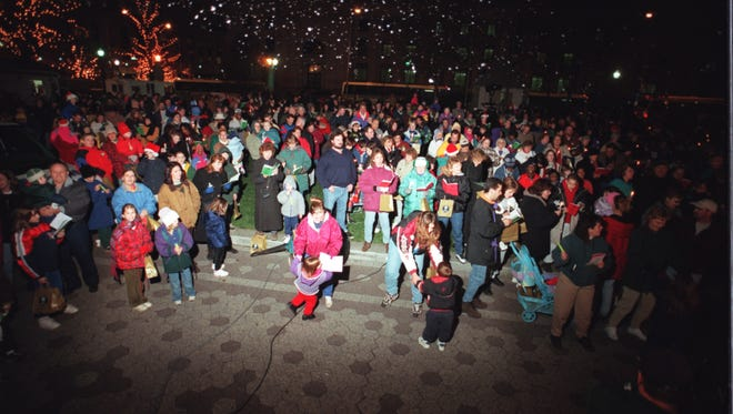 -  -Carolers in Rodney Square draw a crowd  during last year's  Caroling on the Square.