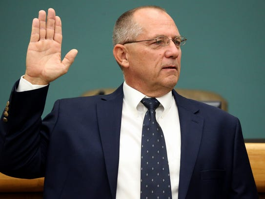 Mayor Dan McQueen takes his oath of office Tuesday,