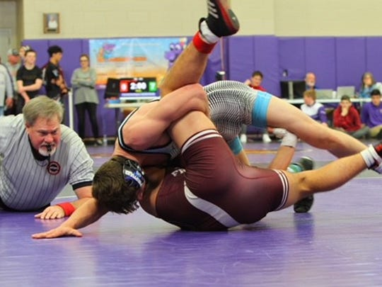 Stephen Little pins his opponent during the tournament.